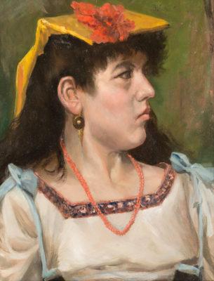 Portrait einer schönen Spanierien mit Korallenkette