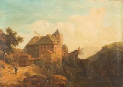 Burganlage vor Gebirgskulisse
