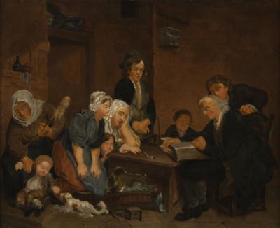 FAMILIE BEIM VORLESEN DER BIBEL